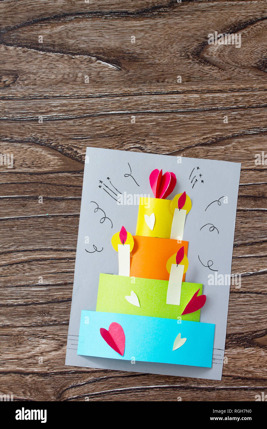 Greeting Card With Birthday Cake Congratulation On A Wooden Table Childrens Art Project Craft For Kids Children Top View Flat Lay Backgr