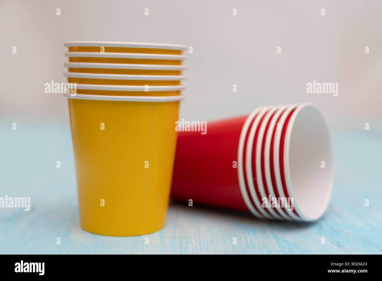 Multicolored disposable paper cups for drinks. - Stock Image