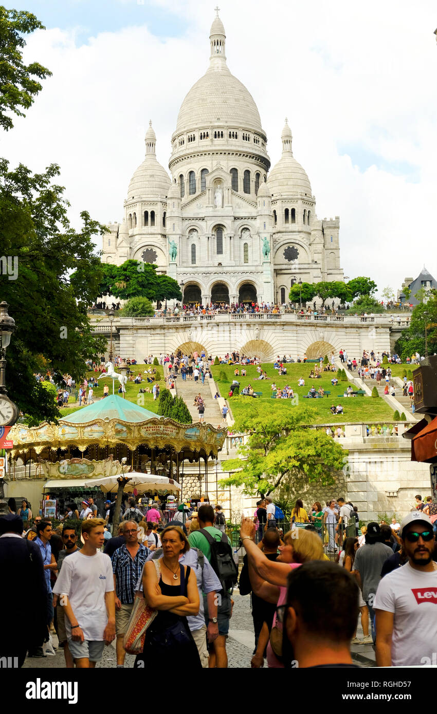 Paris, France - August 14, 2018: Tourists are walking in front of the Sacre-Coeur Basilica, Montmartre, Paris, France - Stock Image