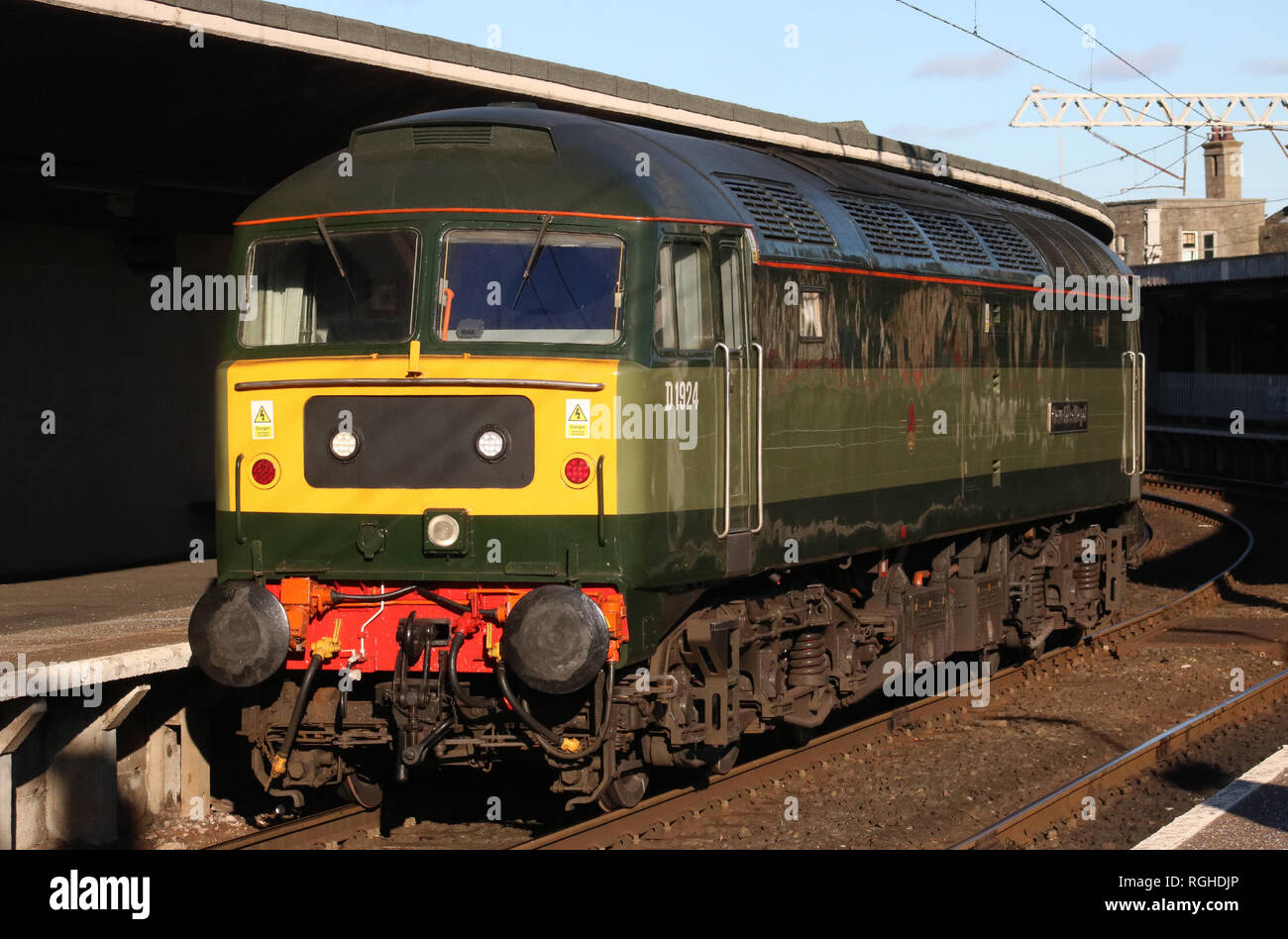 Class 47 diesel-electric locomotive, D1924, in two tone green livery passing through Carnforth station on a light engine movement on 28th January 2019 - Stock Image