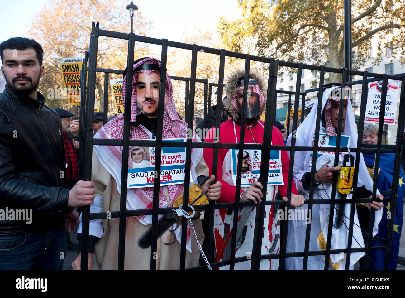 Following killing US Saudi journalist Jamal Khashoggi in Turkey, demonstrators came dressed as Saudi officials, including Saudi Crown Prince Mohammad bin Salman, inside a fake prison cell . - Stock Image