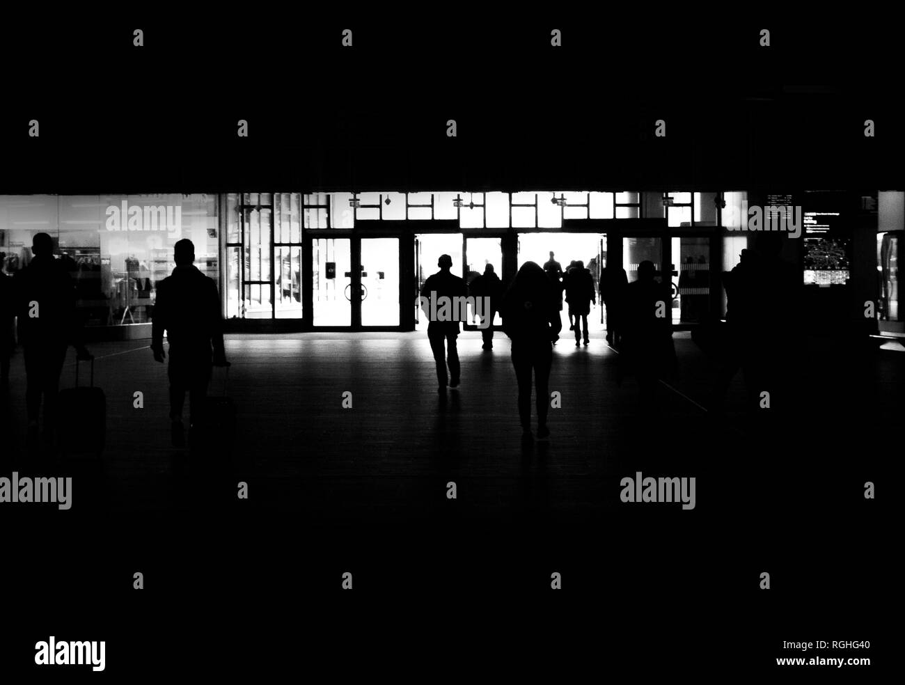 birmingham new street train station. silhouettes of people walking out of the train station. It creates a sense of doorways to heaven - Stock Image