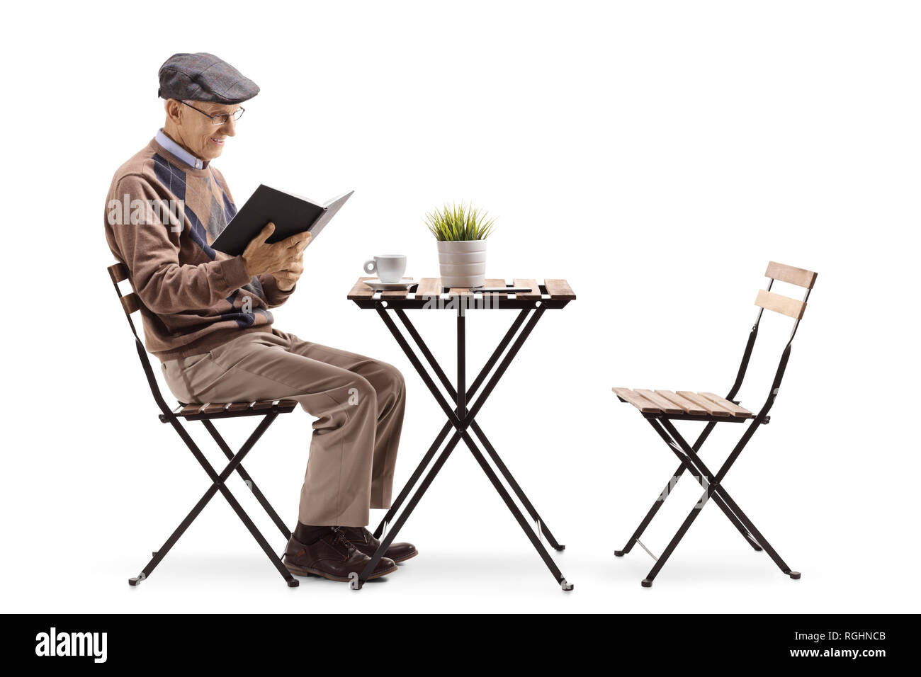 Full Length Shot Of A Senior Man Reading A Book At A Coffee Table