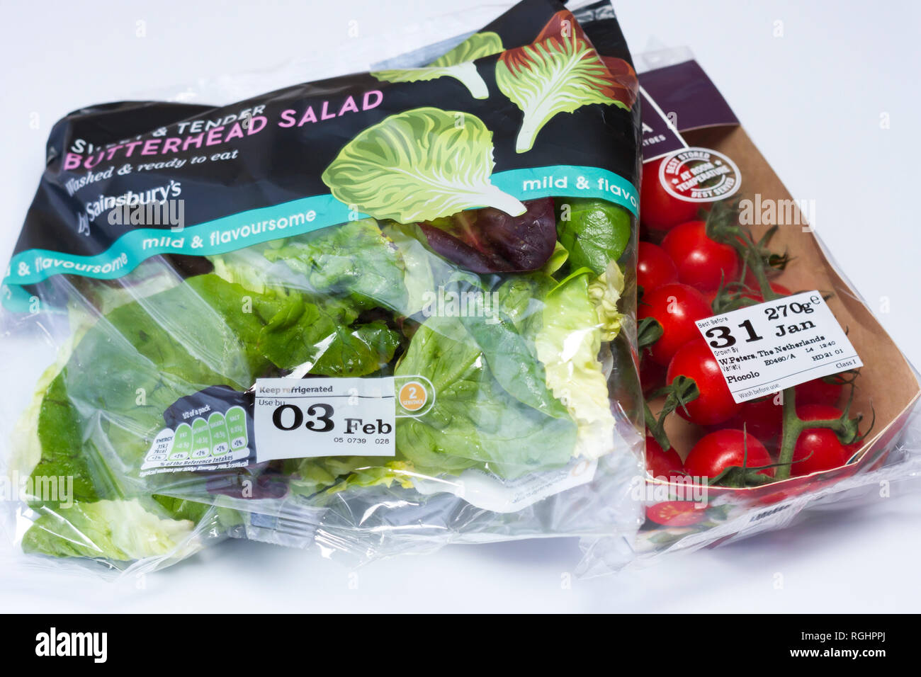 Imported bagged salad and tomatoes. United Kingdom 2019 - Stock Image