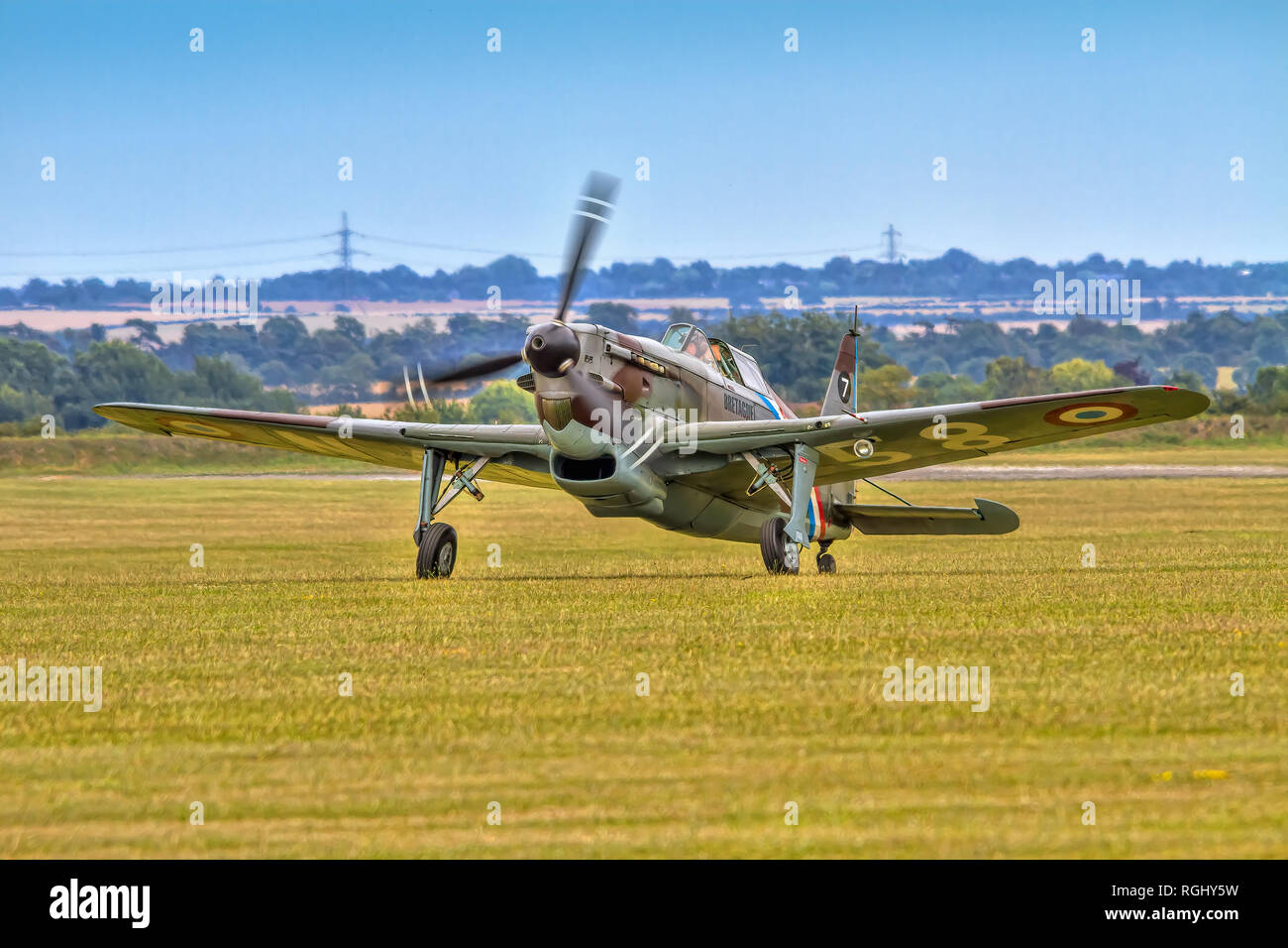 The AMCF's 1941 EFW/Dornier D-3801 HB-RCF taxying in across the grass at Duxford in 2011. It is painted as Morane Saunier MS.406C-1 No138 of the Frenc - Stock Image