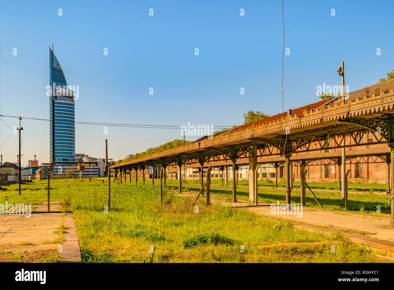 Abandoned old train station with contemporary tower building at background in aguada district, Montevideo, Uruguay Stock Photo