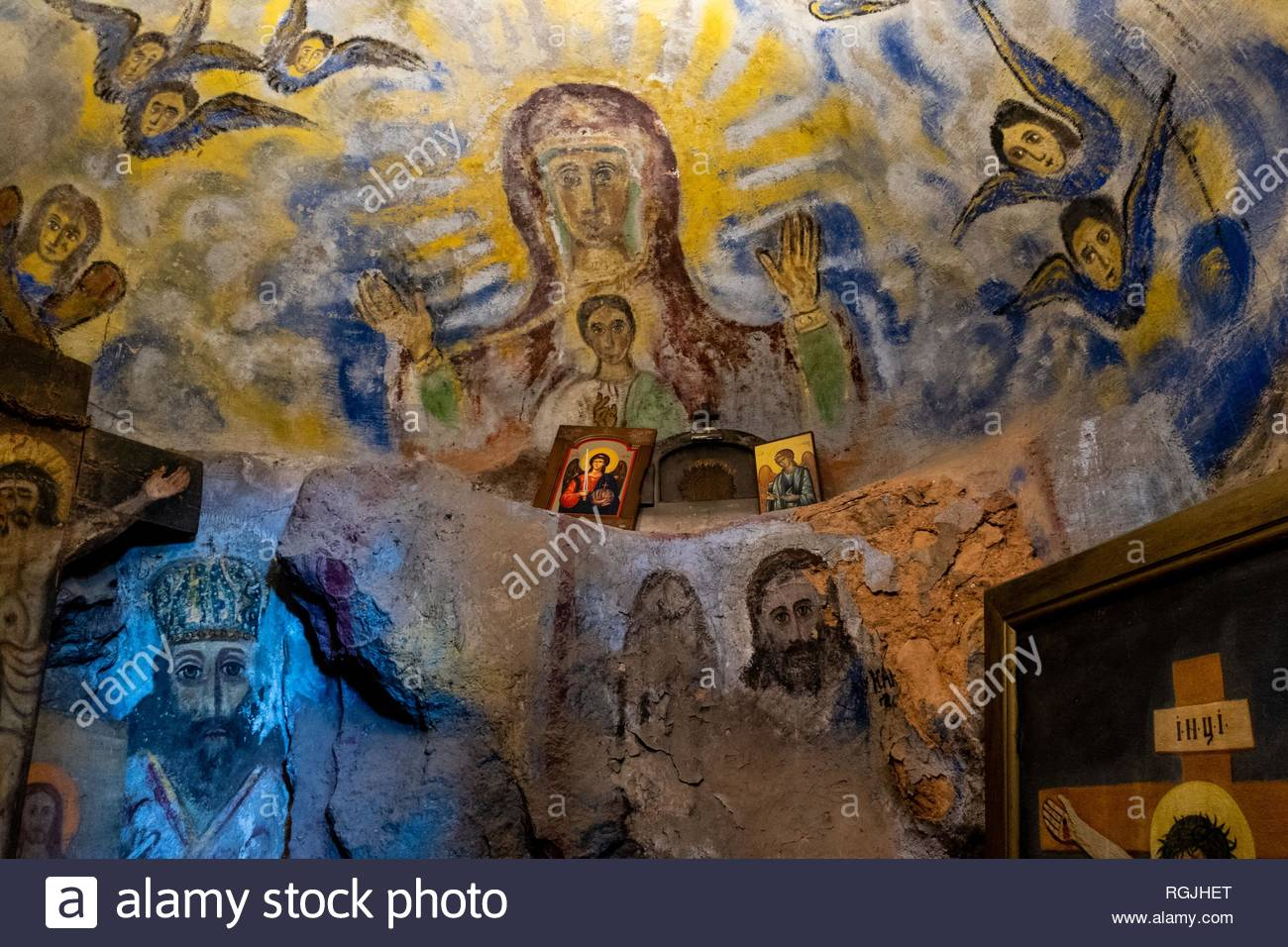 Cave in the Dajbabe Monastery cave church. The catacombs feature colourful frescoes, icons, and altars. Near Podgorica, Montenegro - Stock Image