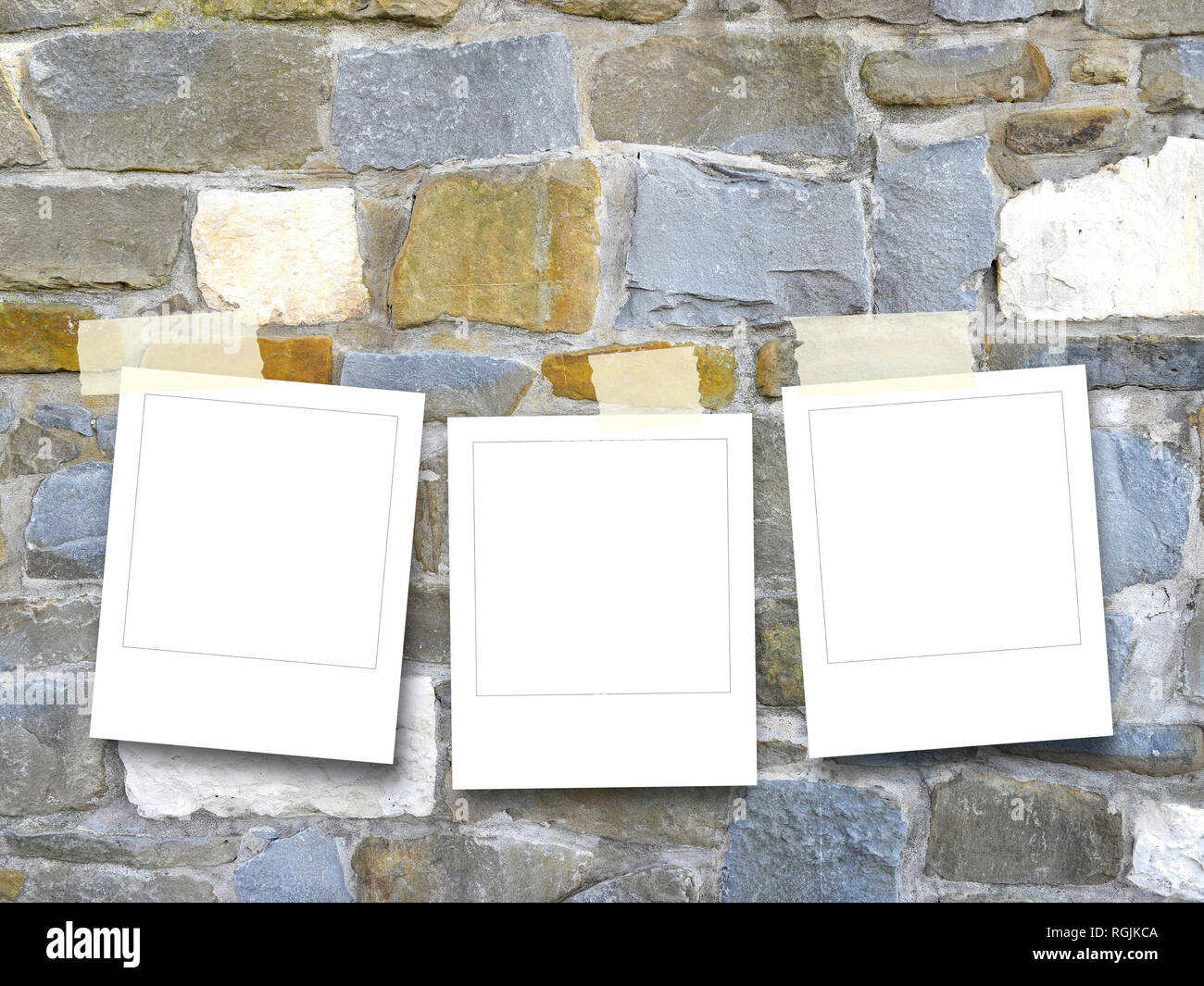 Three blank instant square photo frames on multicolored stone wall background - Stock Image