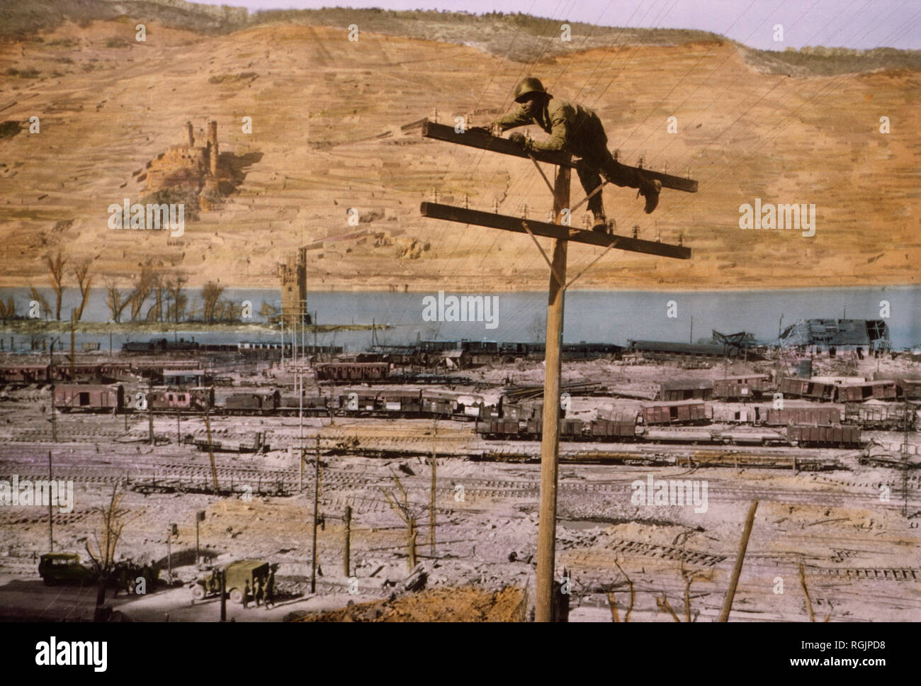 Lineman of Signal Corps Construction Battalion Fastening Wire to Insulator, Bingen on the Rhine, Germany, Central Europe Campaign, Western Allied Invasion of Germany, 1945 Stock Photo