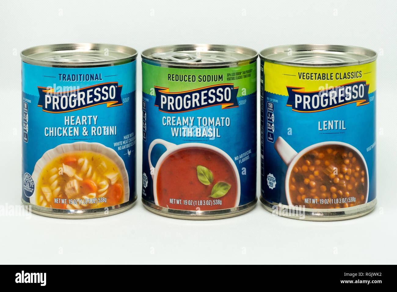 ST. PAUL, MN/USA - JANUARY 27, 2019: Progresso tomato, chicken, and lentil soup cans in grouping of three. - Stock Image