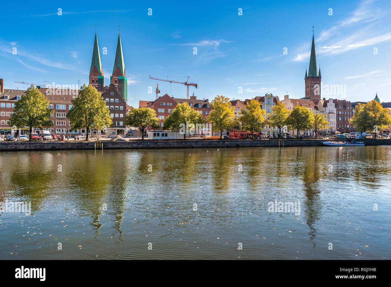 Germany, Schleswig-Holstein, Luebeck, Lower Trave river, St. Mary's Church and St. Petri church - Stock Image