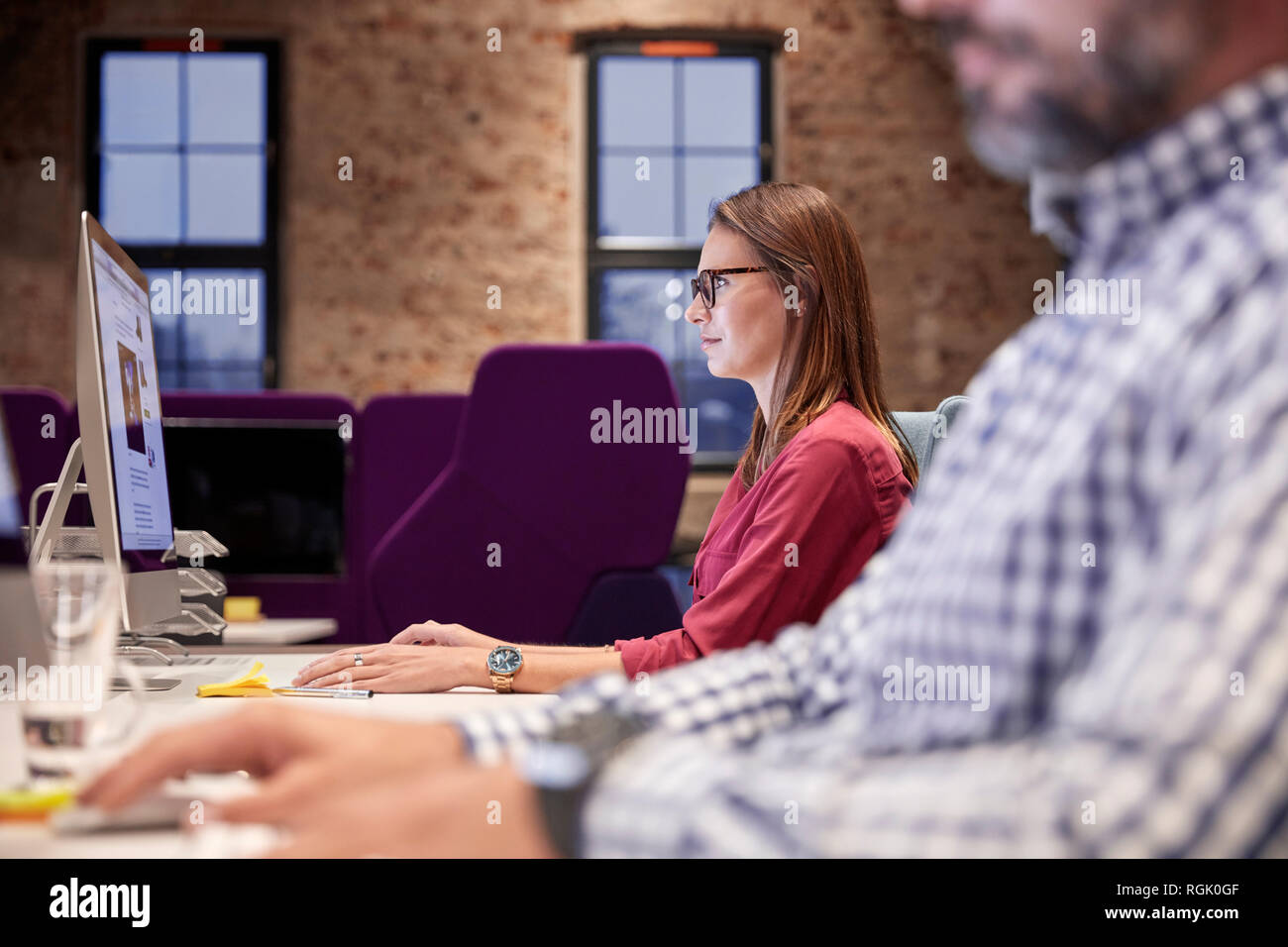Woman  working focused on PC - Stock Image