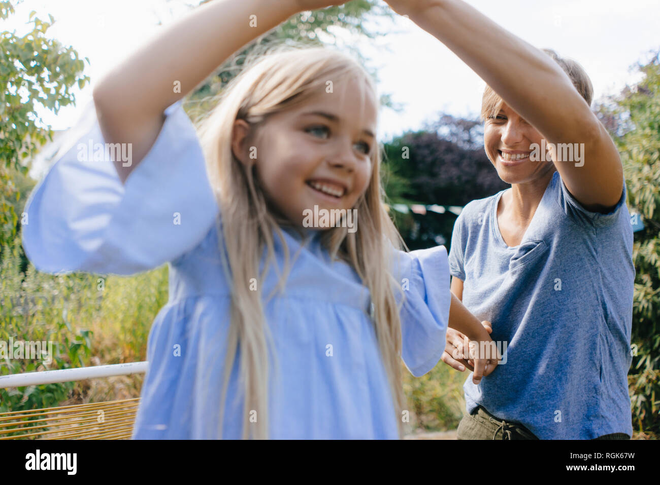 Mother and daughter having fun in garden Stock Photo