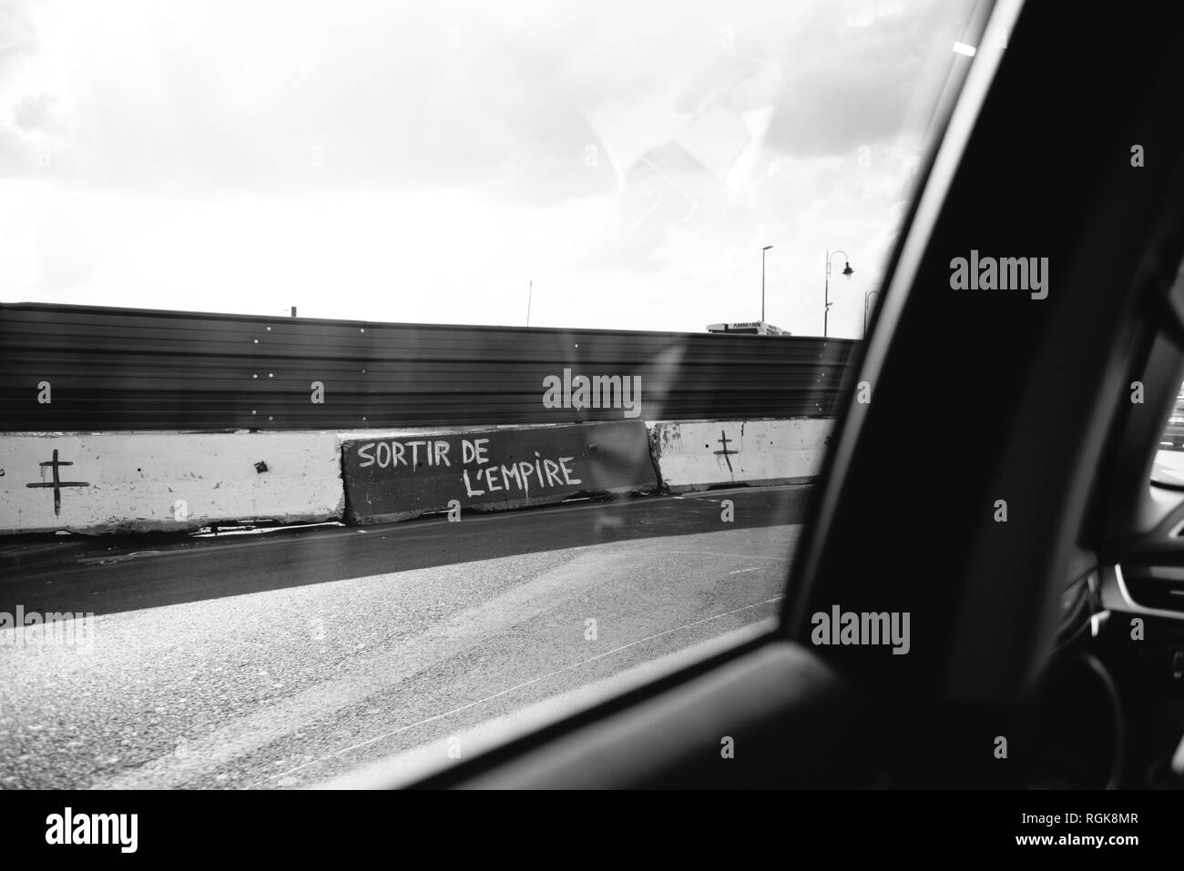 View from the car of graffiti sign on the peripherique highway border of Frexit and Exit from empire sign drawed by anty European Union members - black and white. - Stock Image