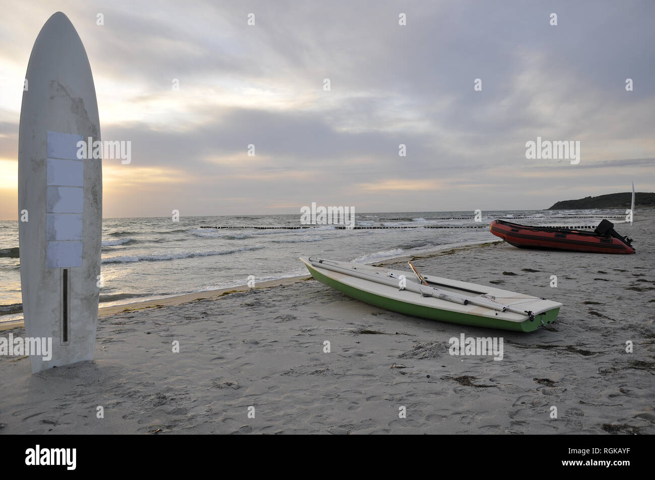 Boats and surfboard on the beach by jziprian - Stock Image