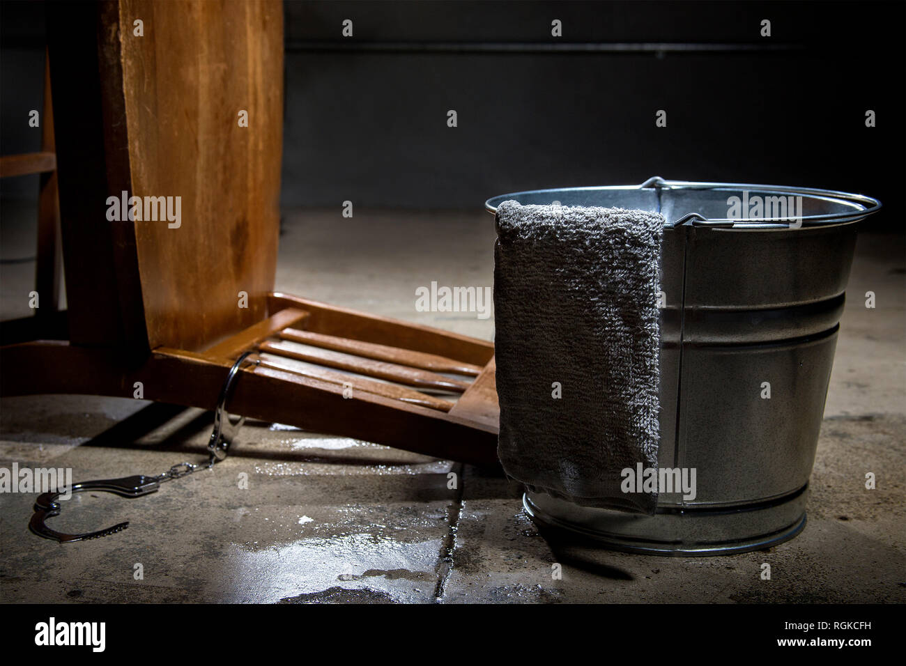 Torture chamber with a water bucket for controversial waterboarding - Stock Image