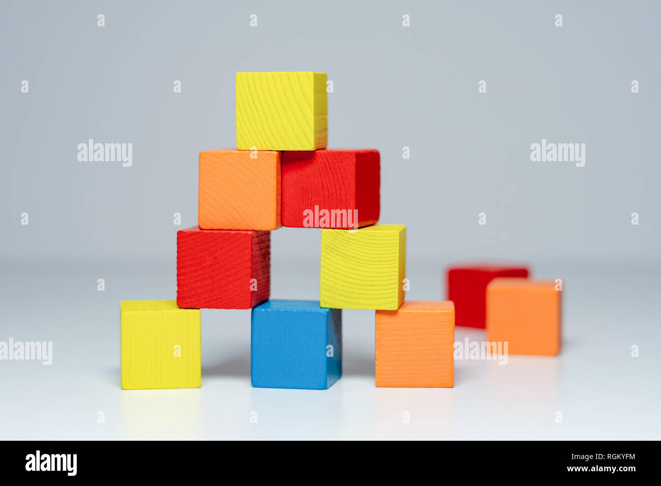Building from wooden colourful childrens blocks Stock Photo