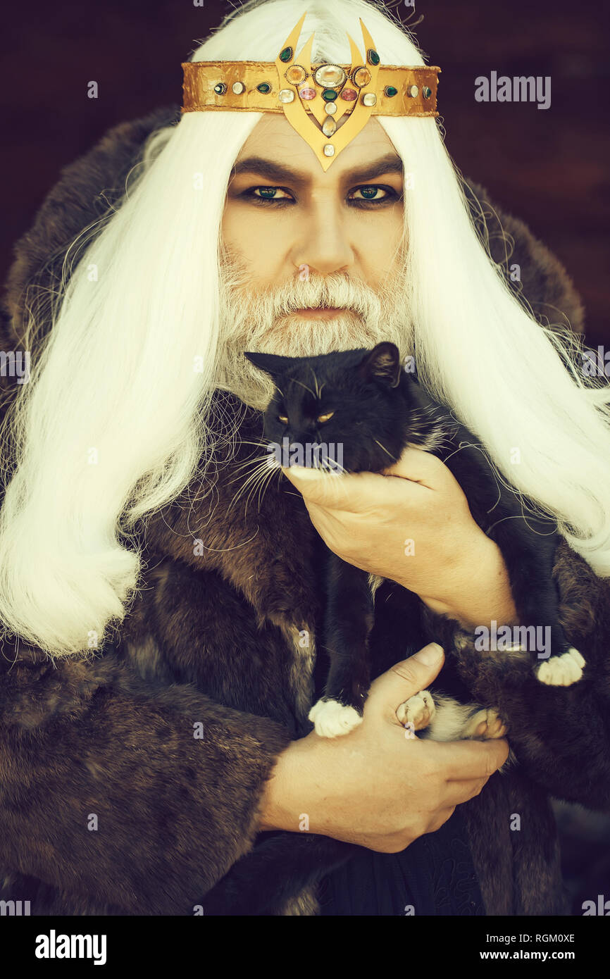 Old druid with cat - Stock Image