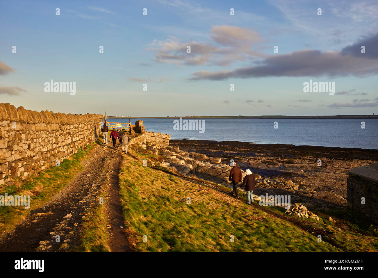 The low winter sun making for a good walk at Scarlett, Castletown, Isle of Man - Stock Image