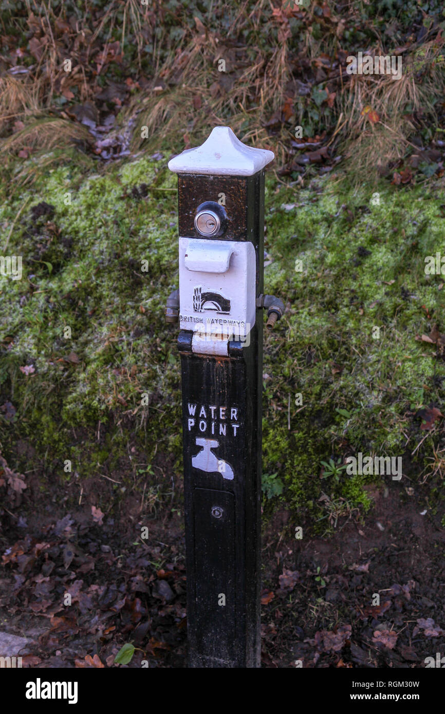 A British Waterways water point column, enabling canal boats to fill up with water, next to the Llangollen Canal Cheshire England UK - Stock Image
