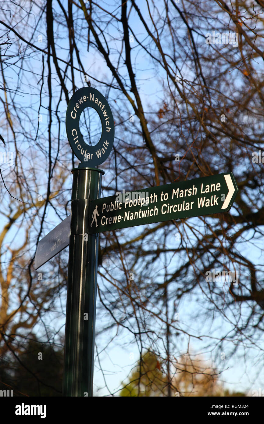 A metal sign post or finger post saying 'Crewe-Nantwich circular walk' marking a public footpath - Stock Image