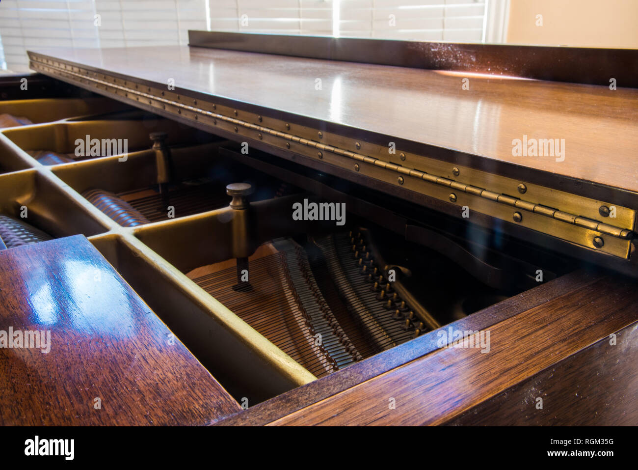 Piano hinge and sound board on a grand piano. - Stock Image