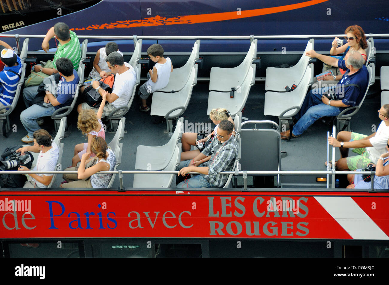 Tourists in Open-Top Tourist Bus or Sightseeing Bus Paris France - Stock Image