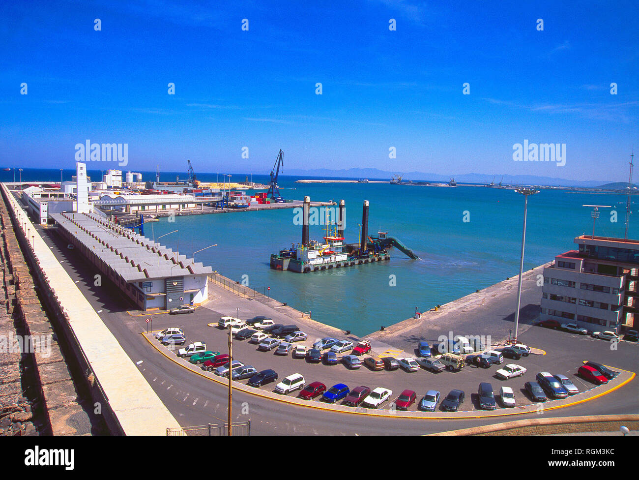 Dredge working in the harbour. Melilla, Spain. - Stock Image