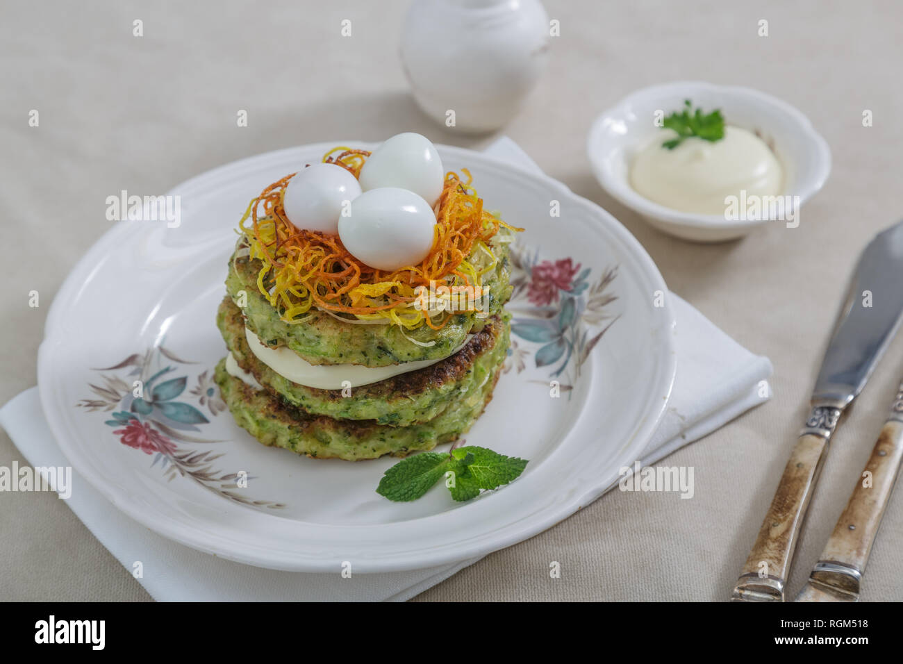 Healthy breakfast with zucchini fritters and eggs - Stock Image