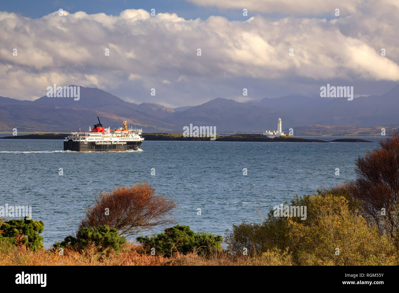 The Cragnure to Oban Ferry with Lismore Lighthouse in the distance. - Stock Image