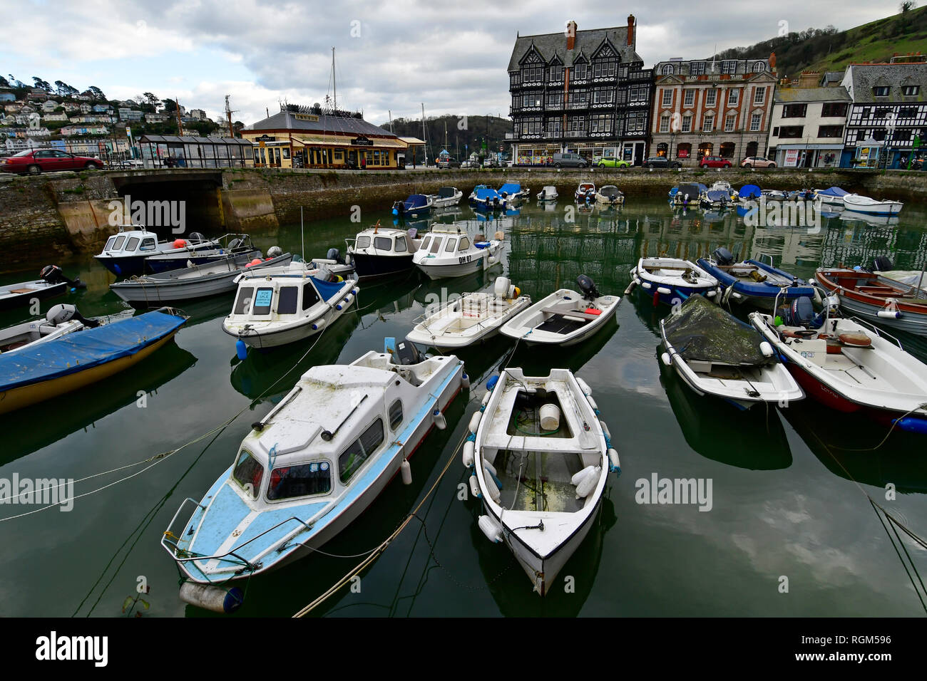 UK Weather.On mild and overcast afternoon on the River Dart,boats and small craft can be seen mored up in harbour. Picture Credit Robert Timoney/Alamy - Stock Image