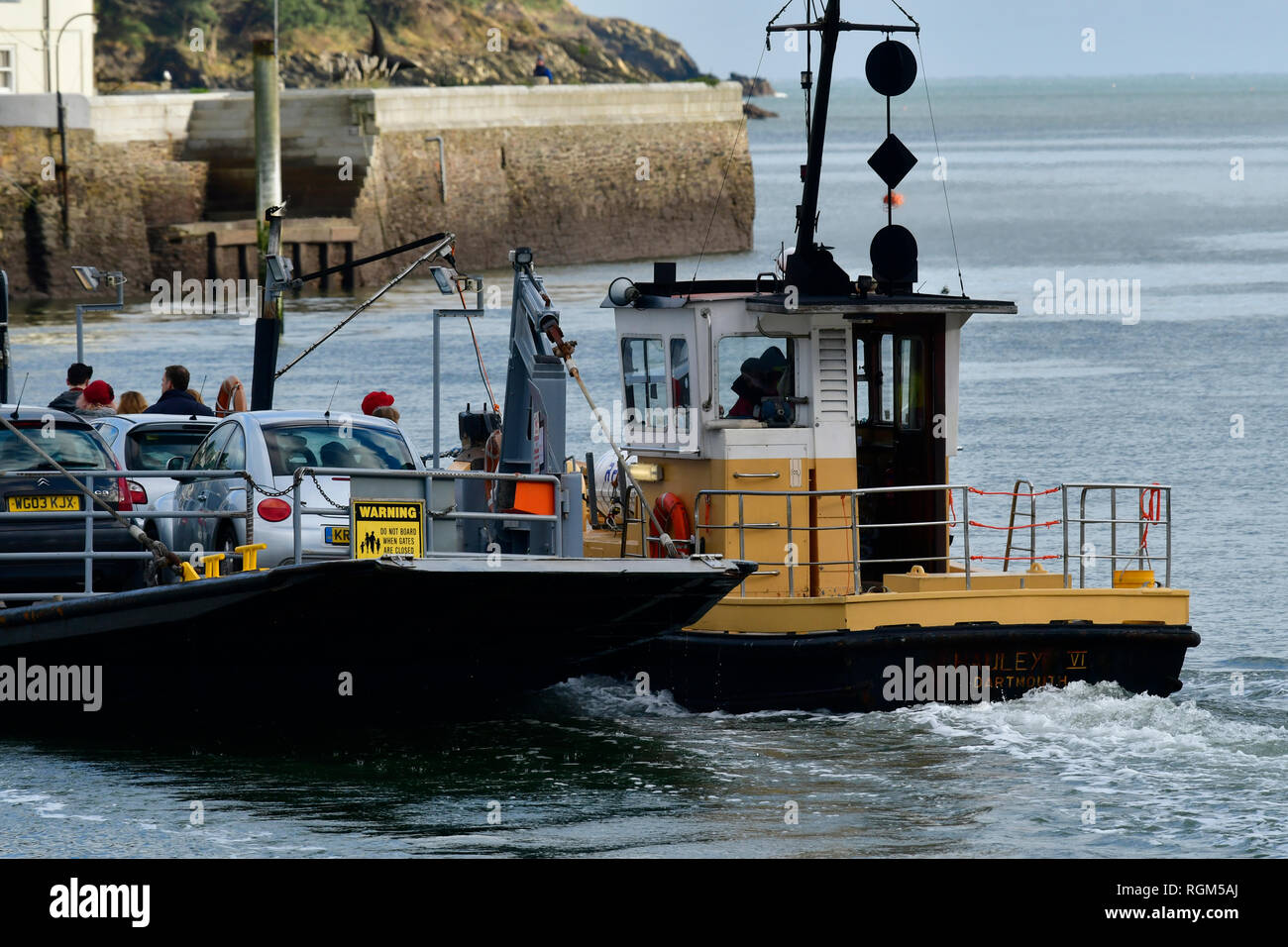 UK Weather.On mild and overcast afternoon on the River Dart,people can be seen crossing on the Lower ferry by car and as foot passengers,and the hills - Stock Image