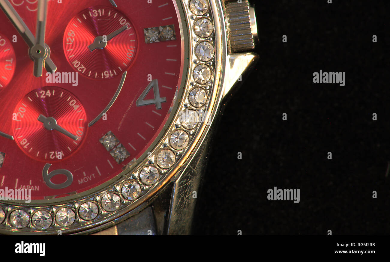 red women,s watch with diamonds - Stock Image