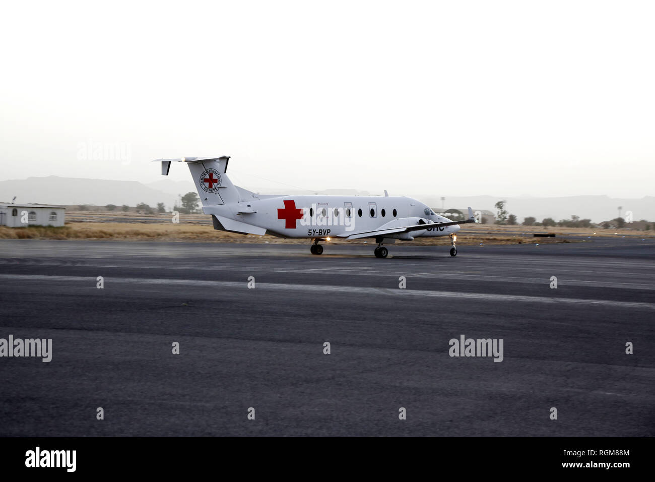 """Sanaa, Yemen. 29th Jan, 2019. A plane of the International Committee of the Red Cross (ICRC) takes off as it carries Musa Awagi released by the Houthi rebels at the Sanaa International Airport, in Sanaa, Yemen, on Jan. 29, 2019. Yemen's Houthi rebels on Tuesday handed over a captured Saudi soldier to the ICRC, the rebels said in a statement. """"The sick Saudi soldier Musa Awagi will be transported to his country through an ICRC plane today (Tuesday),"""" the statement said. Credit: Mohammed Mohammed/Xinhua/Alamy Live News Stock Photo"""