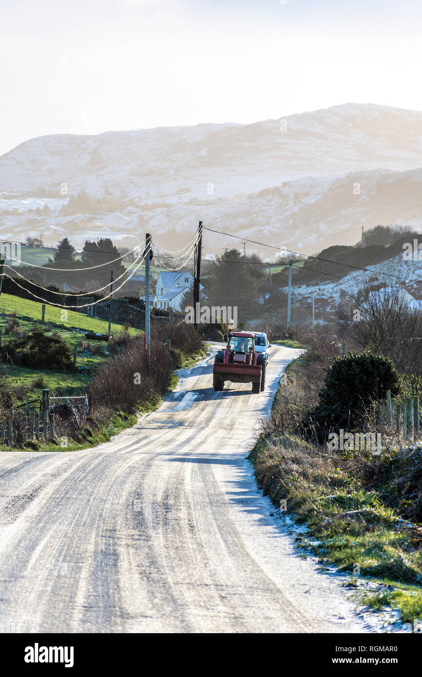 Ardara, County Donegal, Ireland. 30th January 2019. Tricky conditions on ungritted minor roads this morning. The sun melting overnight snow but more is predicted later today. Credit: Richard Wayman/Alamy Live News - Stock Image