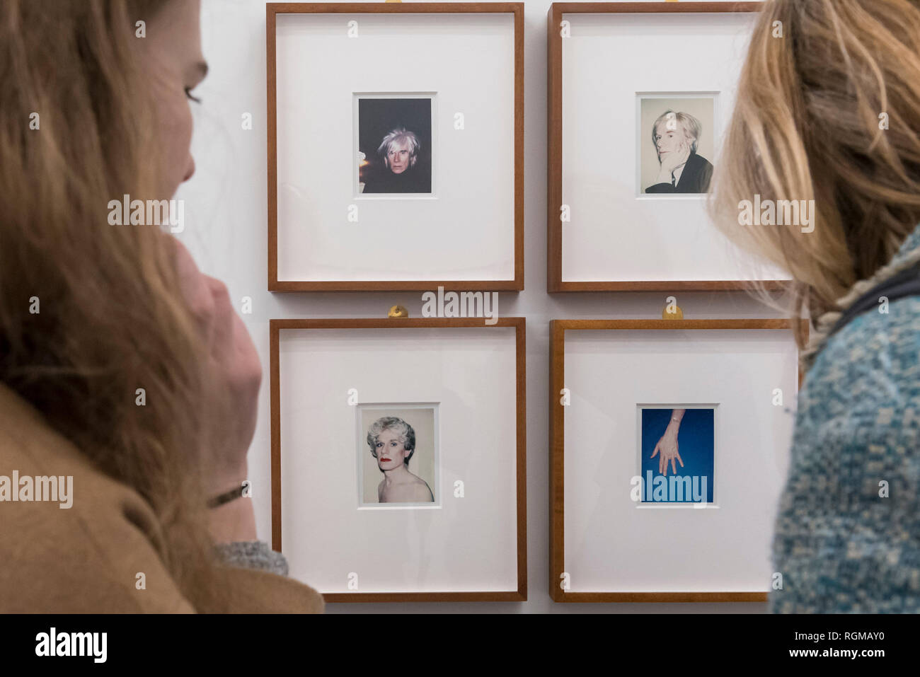 London, UK.  30 January 2019. Visitors view a series of self-portraits (1977 to 1986) by Andy Warhol. Preview of 'Andy Warhol Polaroid Pictures', an exhibition of over 60 portrait and self-portrait Polaroid photographs by Andy Warhol.  The works, which depict artists, actors, politicians and friends of his Factory entourage in New York during the 1970s and 80s, are on display 2 February to 13 April 2019 at Bastian Gallery in Mayfair.  Credit: Stephen Chung / Alamy Live News - Stock Image