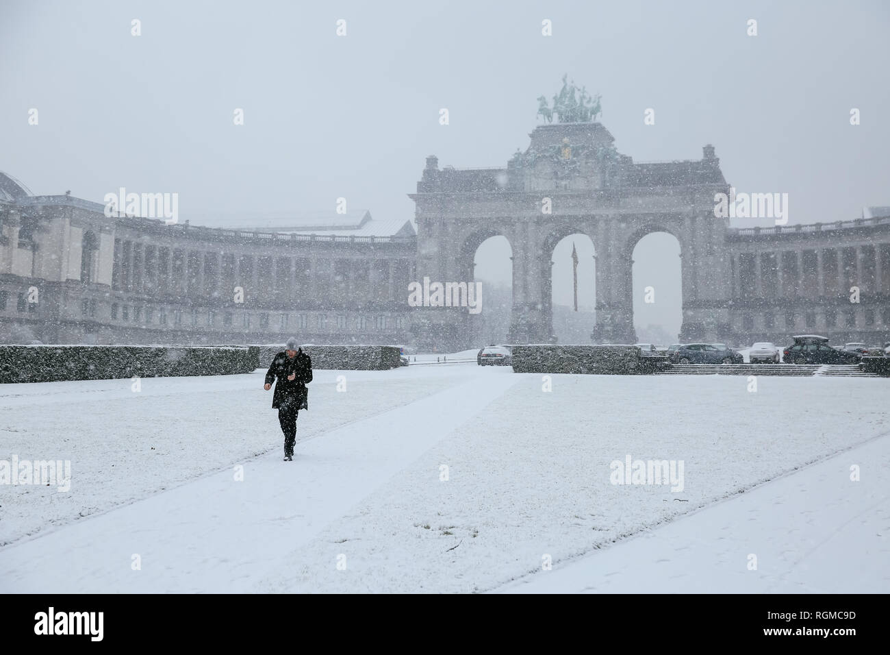 Brussels, Belgium. 30th Jan, 2019. A man walks in the Park of the Fiftieth Anniversary in Brussels, Belgium, Jan. 30, 2019. A snowfall hit Brussels on Wednesday. Credit: Zhang Cheng/Xinhua/Alamy Live News - Stock Image