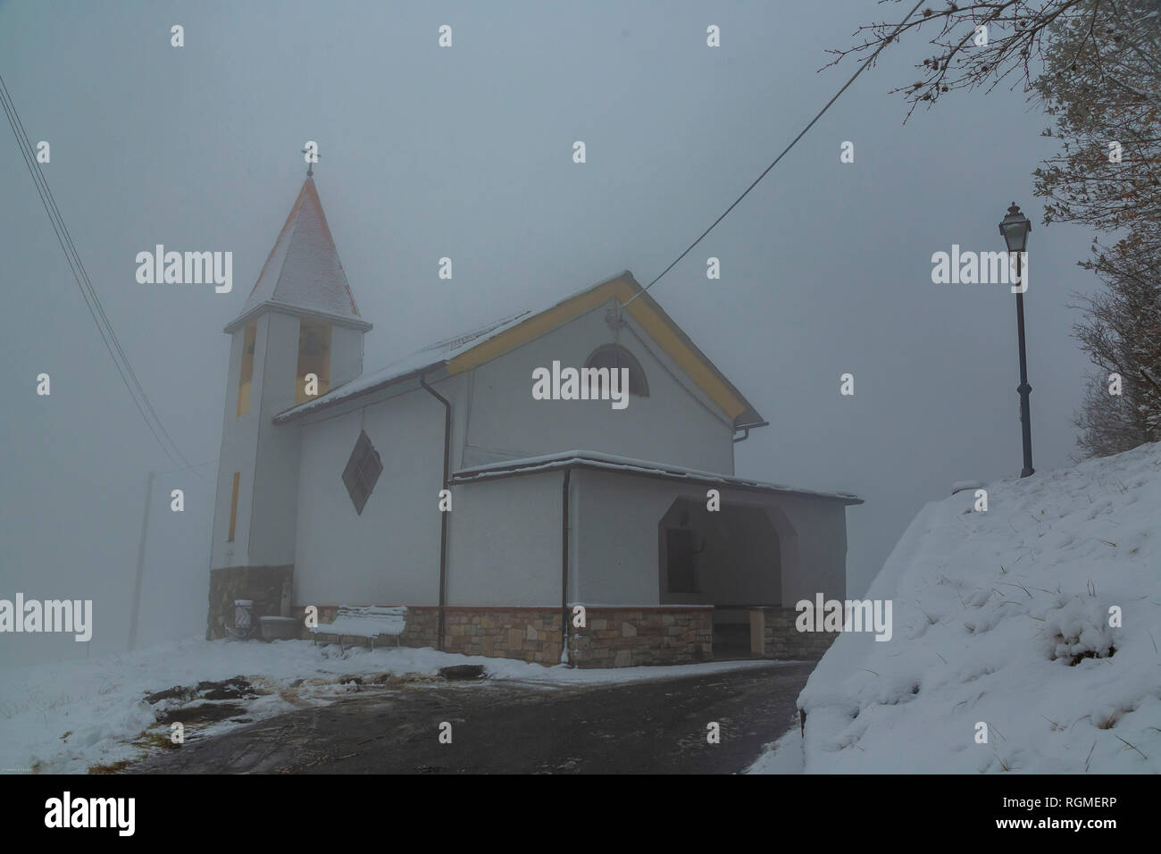 Genoa, Italy. 30th January 2019.   View of the church of Costalovaia,30 Km north of Genoa, 480 meters above sea level, during today's snowfall in Liguria on January 30, 2019 in Genoa, Italy. A cold snap has hit Italy this week with snow forecast in  other cities Italy. (Photo by Awakening/Getty Images) Credit: Awakening/Alamy Live News - Stock Image