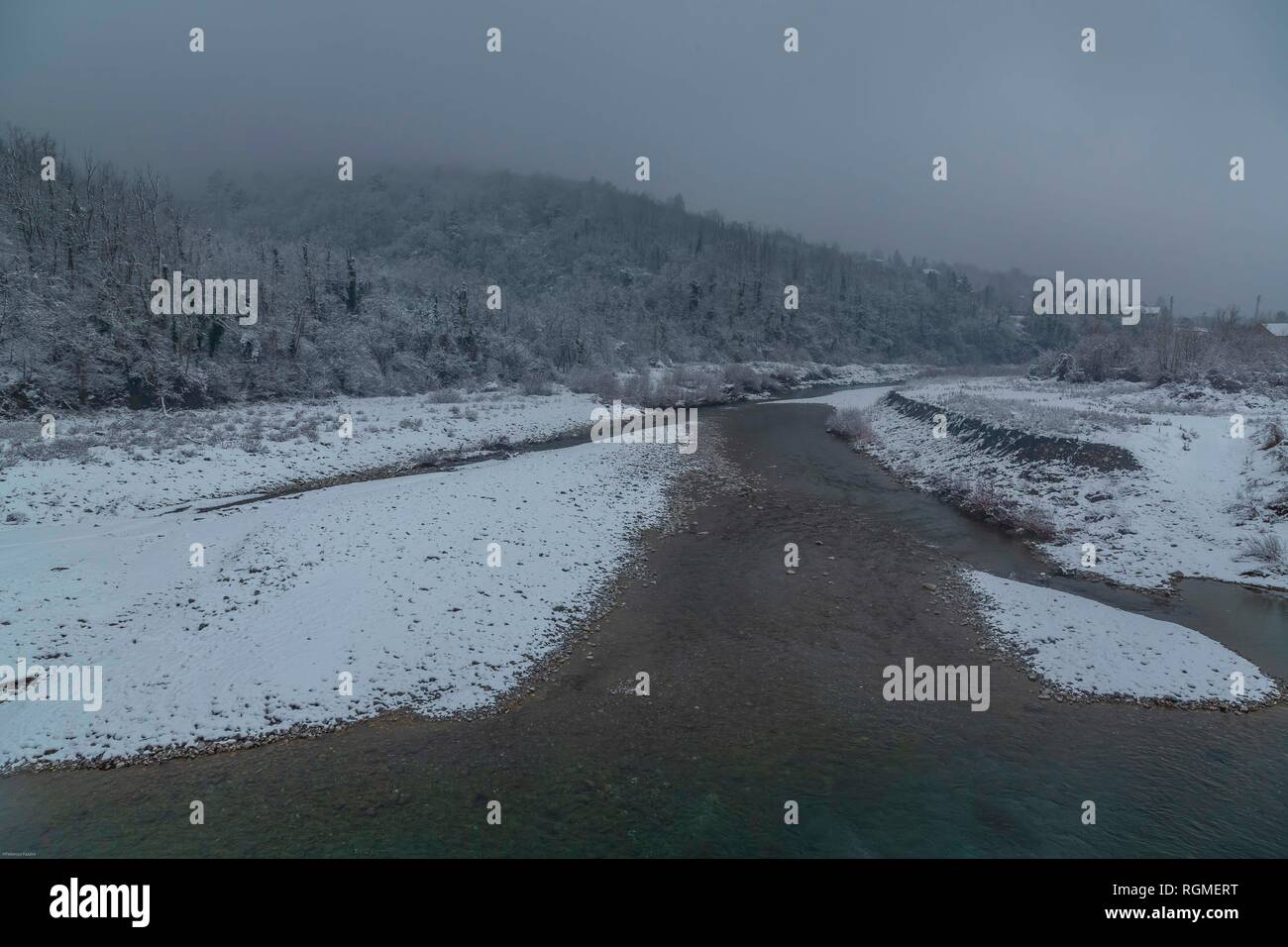 Genoa, Italy. 30th January 2019.   View of the torrent Scrivia 30 Km north of Genoa, 460 meters above sea level, during today's snowfall in Liguria on January 30, 2019 in Genoa, Italy. A cold snap has hit Italy this week with snow forecast in  other cities Italy. (Photo by Awakening/Getty Images) Credit: Awakening/Alamy Live News - Stock Image