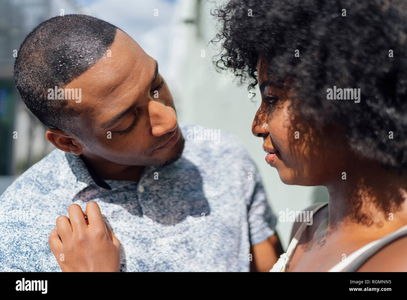 Affectionate young couple facing each other Stock Photo