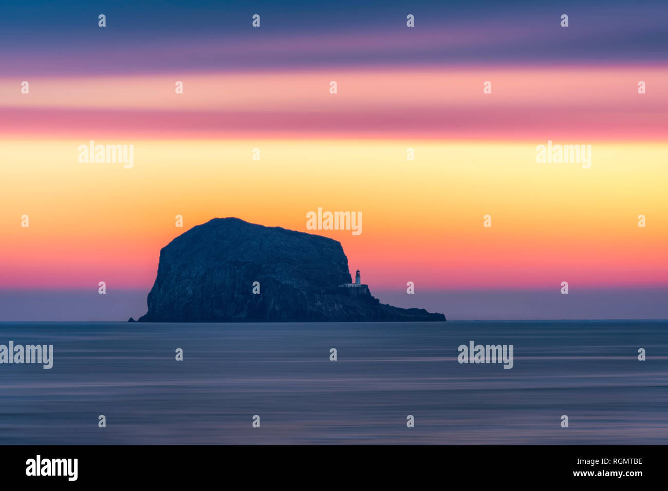 Great Britain, Scotland, East Lothian, North Berwick, Firth of Forth, view of Bass Rock at sunrise, lighthouse Stock Photo