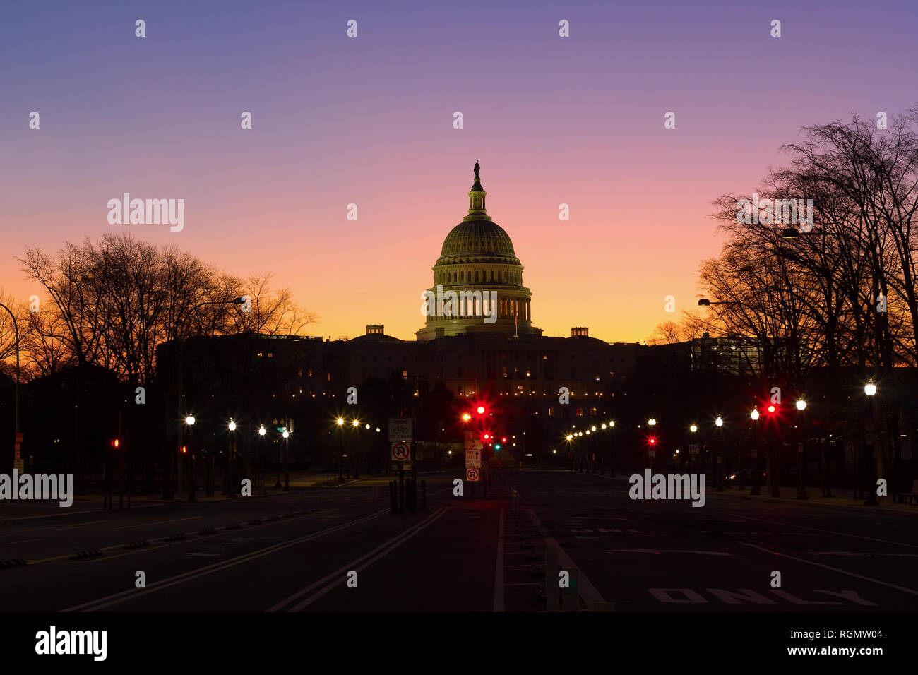 A view on US Capitol from Pennsylvania avenue at dawn in Washington DC, USA. Beautiful winter sunrise with clear skies. Stock Photo