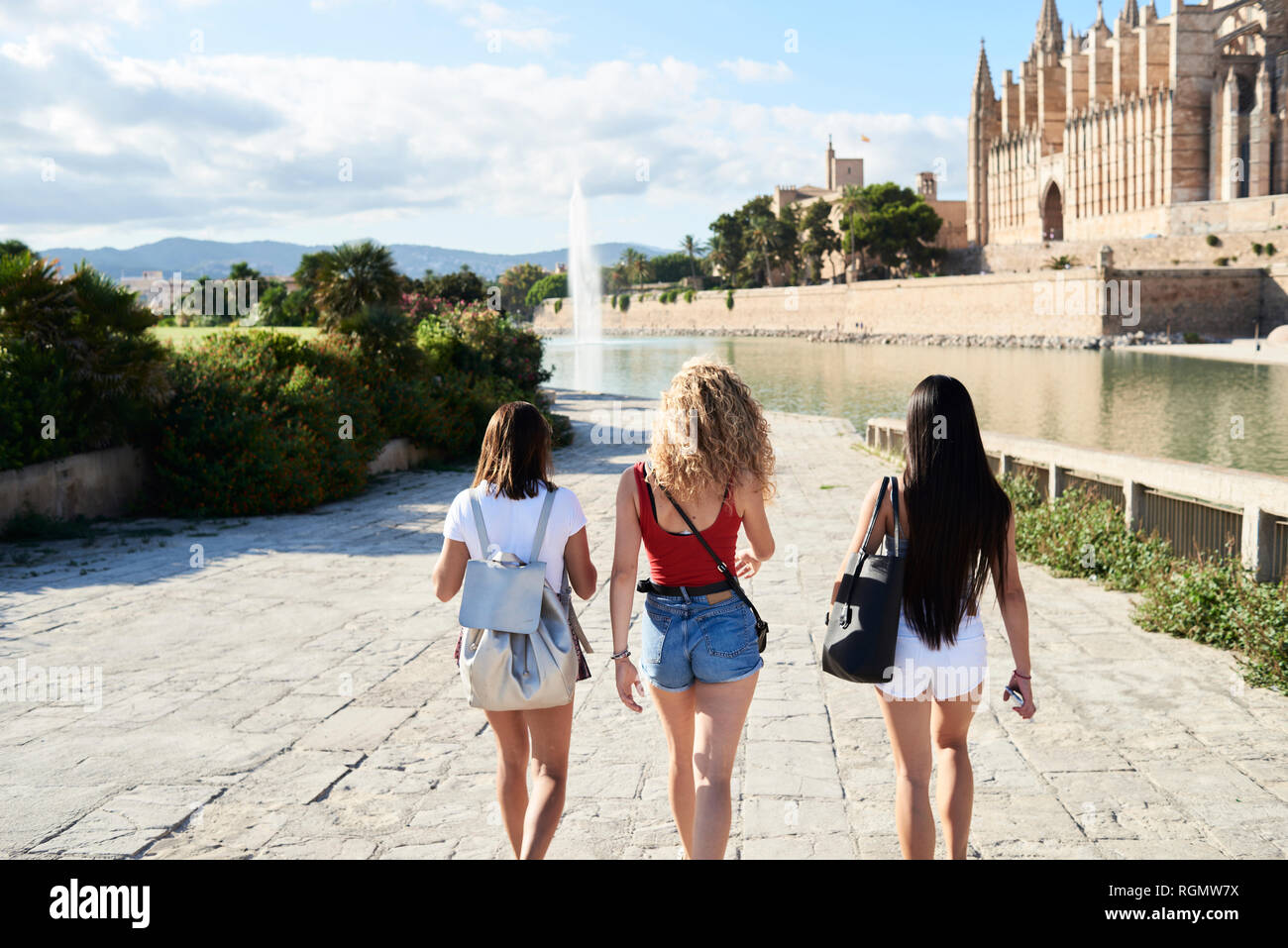 Spain, Mallorca, Palma, rear view of three young women exploring in the city - Stock Image