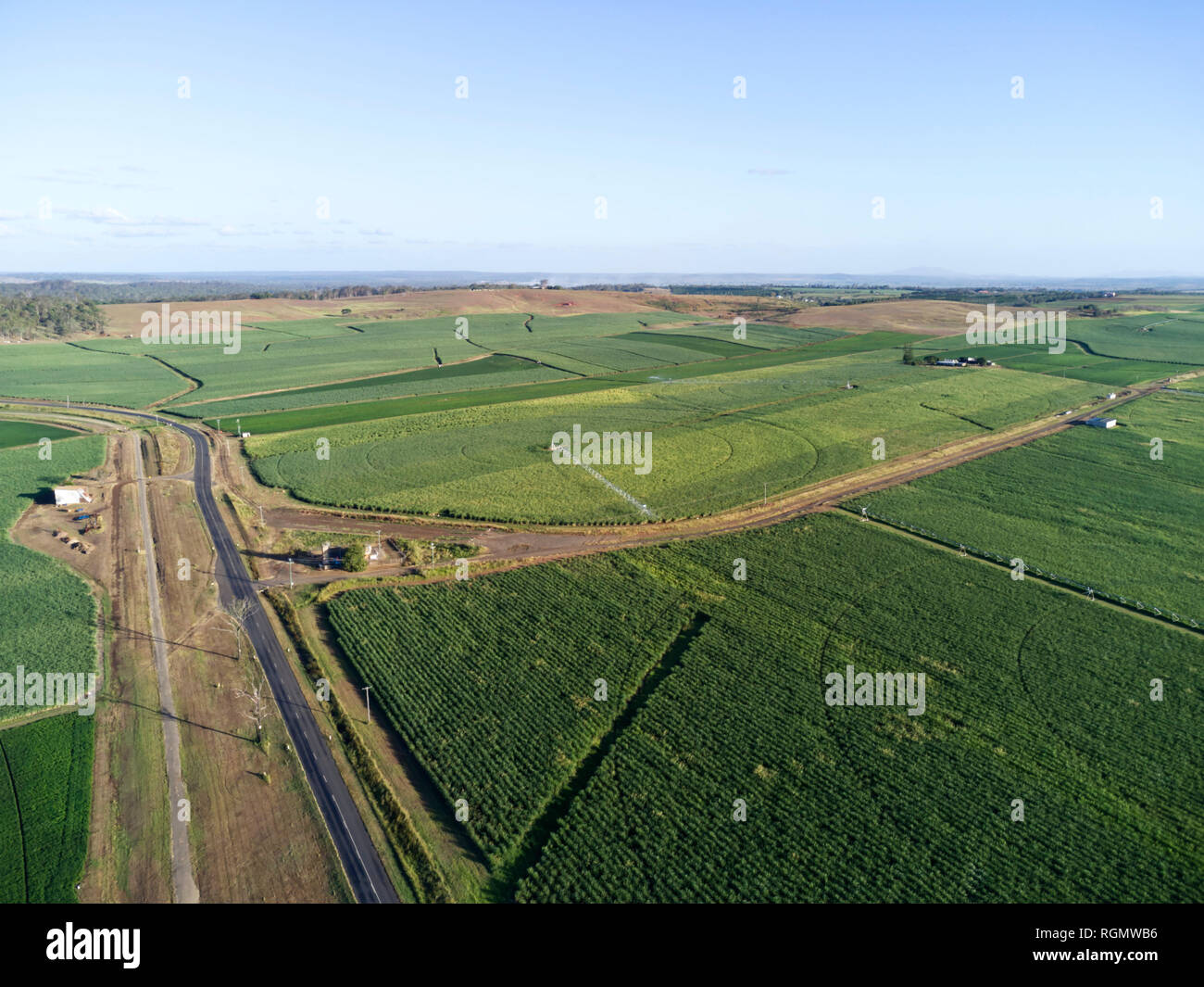 Aerial of centre pivoted irrigated sugar cane fields near Gin Gin Queensland Australia - Stock Image