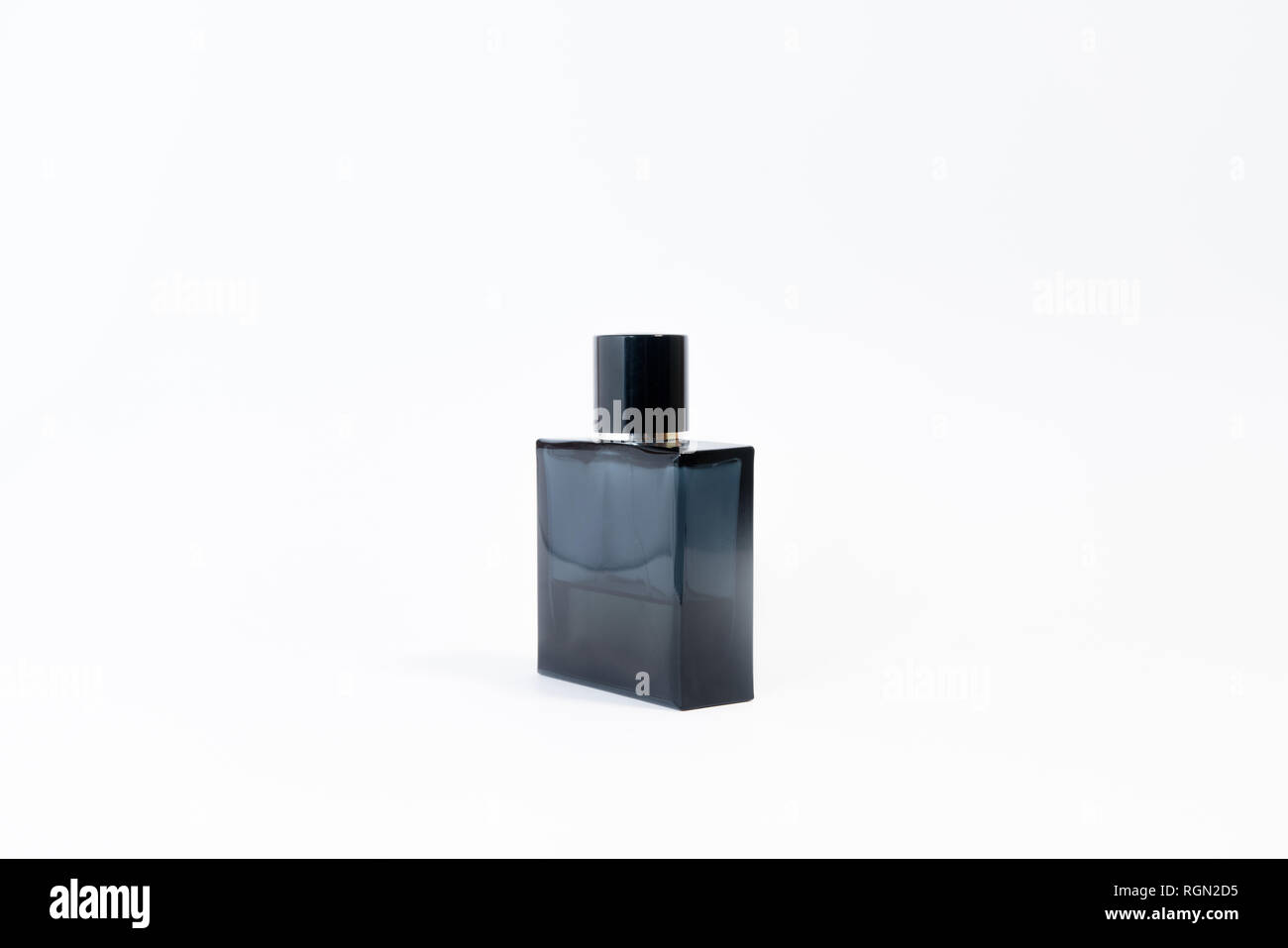 Luxury glass perfume bottle on white background. Copy space for text, blank bottle - Stock Image