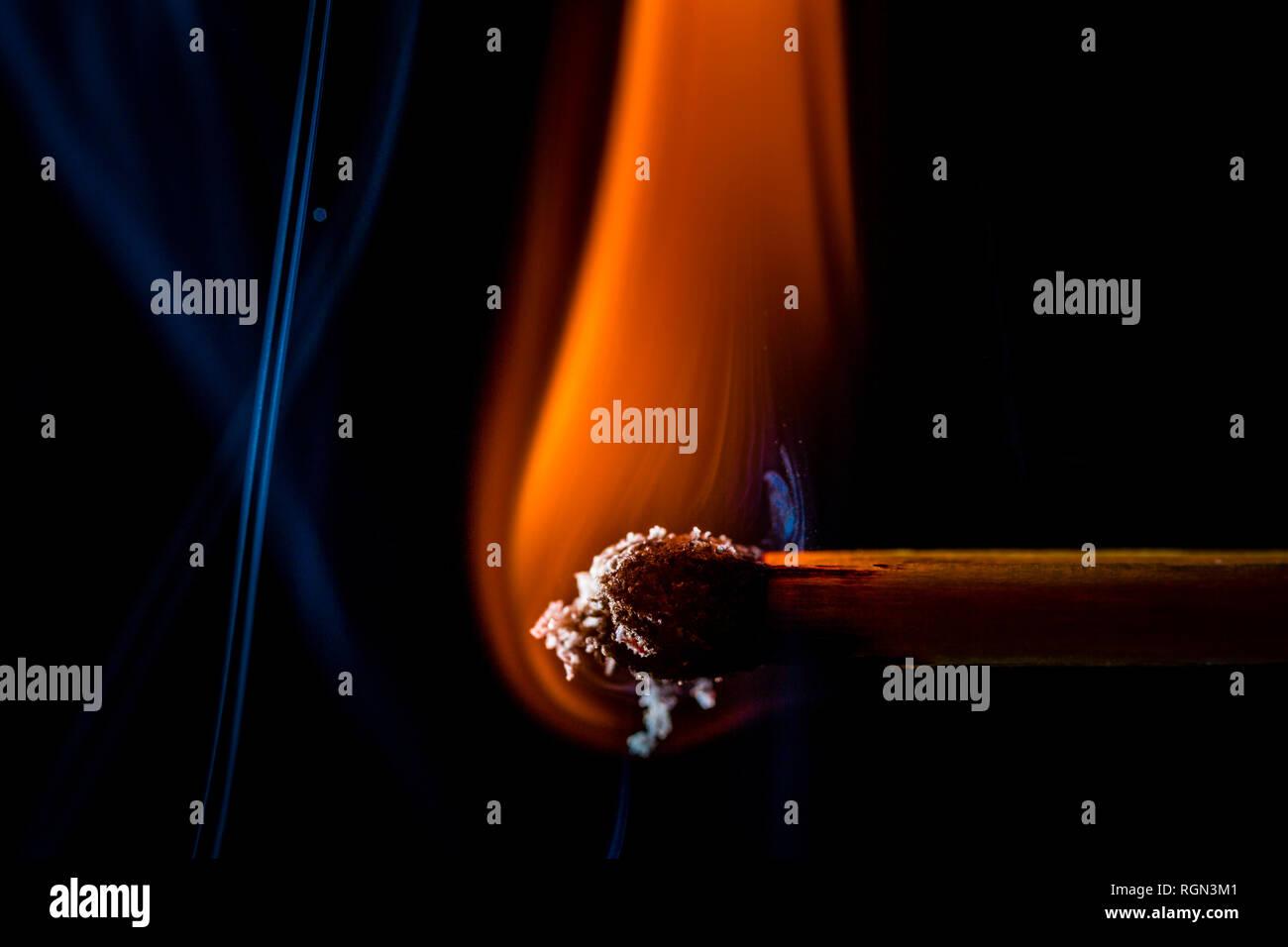 Burning matchstick, macro - Stock Image