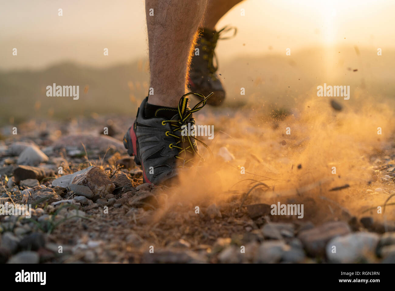 Close-up of feet of a trail runner - Stock Image