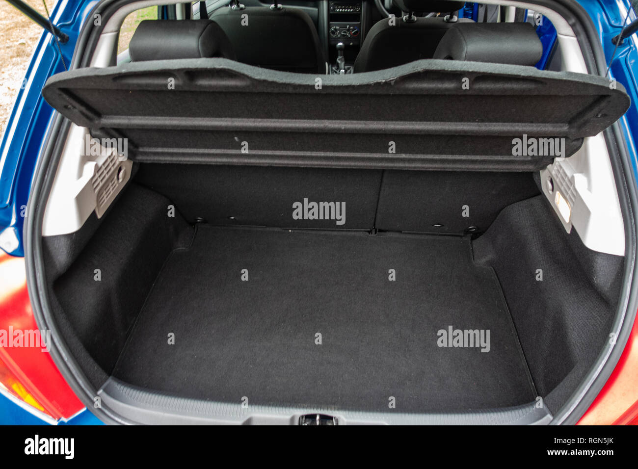 Empty space in the boot space of  a Peugeot 207 5 door 2009 car in England - Stock Image
