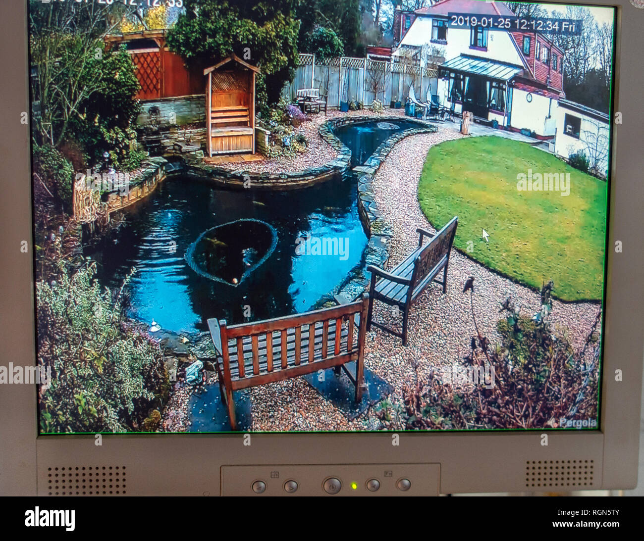 Monitor showing CCTV Camera surveillance from Multiple DVR Locations around a home and gardens at a private home in England - Stock Image