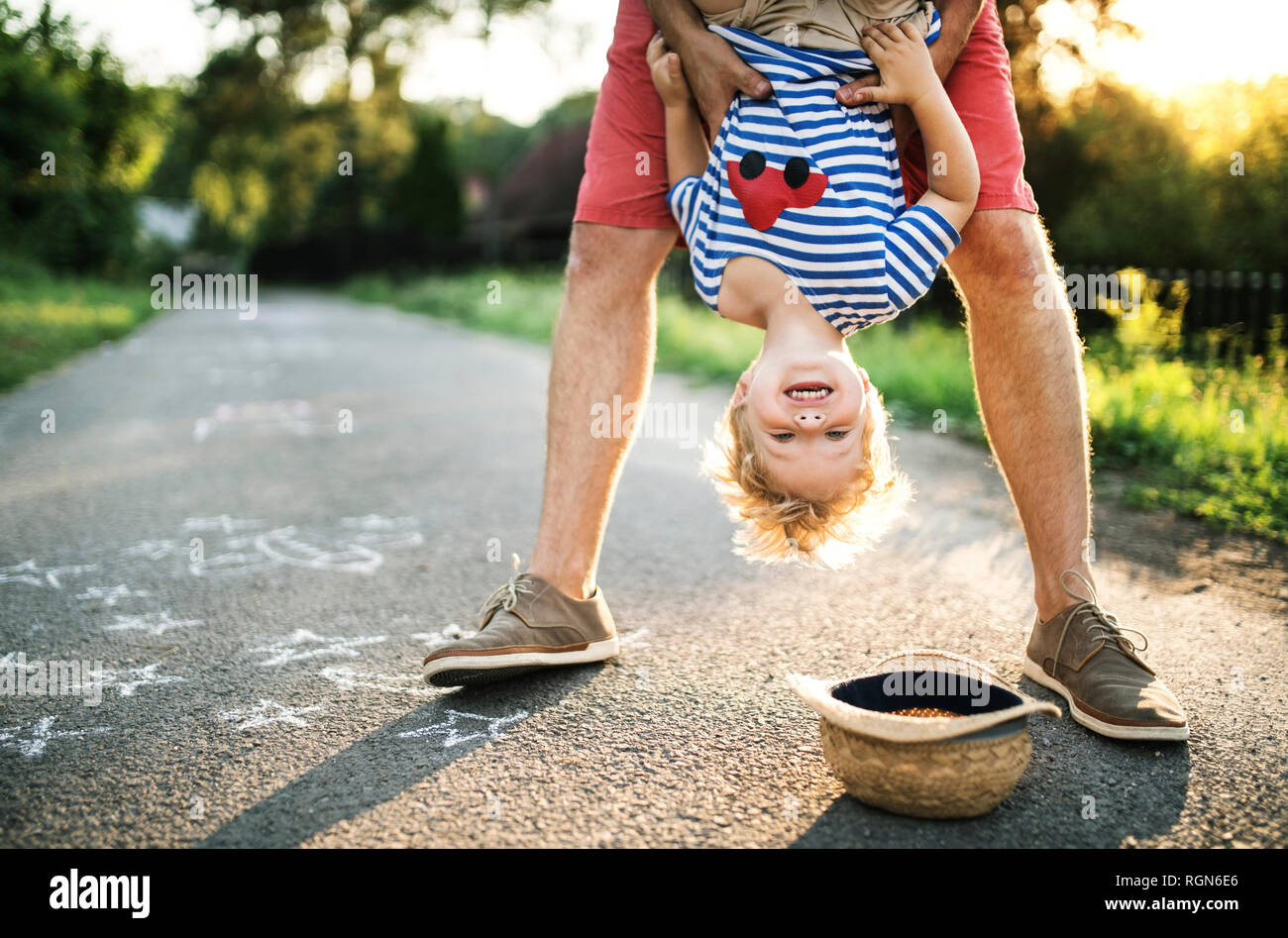 Portrait of laughing toddler having fun with his father outdoors Stock Photo